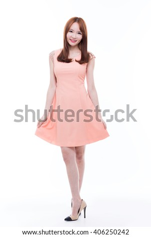 Beautiful young Asian Lady isolated on white background. she has nice dress. - stock photo