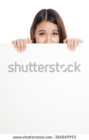 Beautiful young Asian woman behind a blank sign  isolated on white background
