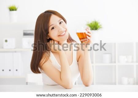 beautiful Young asian woman drinking hot tea - stock photo