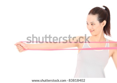 Beautiful young Asian woman get in shape - stock photo