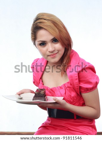 Beautiful young asian woman holding cake isolated white background - stock photo