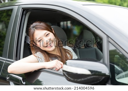 Beautiful young asian woman in a car