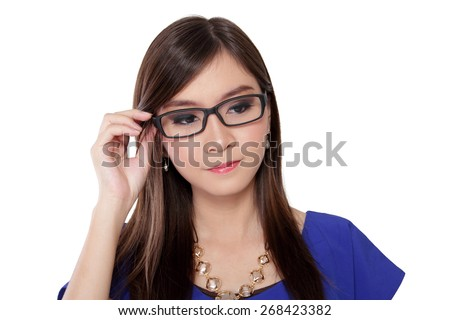 Beautiful young Asian woman looking away from camera while holding her glasses, on white background - stock photo