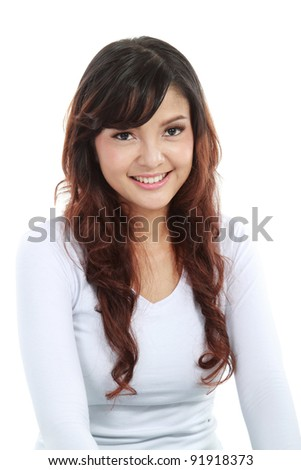 Beautiful young asian woman looking happy isolated over white background - stock photo