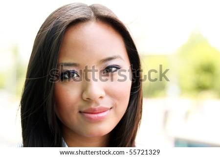 Beautiful young asian woman outdoors - stock photo