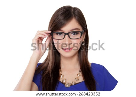 Beautiful young Asian woman smiles at camera while holding her glasses, on white background - stock photo