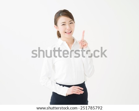 Beautiful young asian woman to recommend it to - stock photo