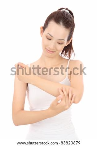 Beautiful young Asian woman touching hands - stock photo