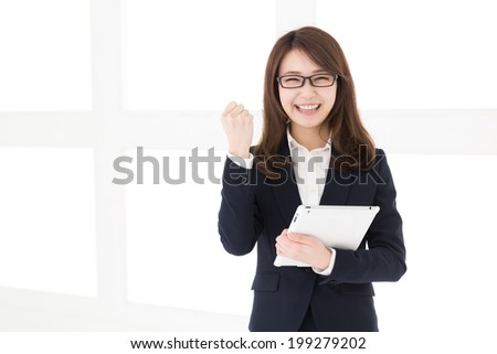 Beautiful young asian woman using tablet computer - stock photo