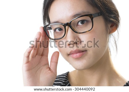 Beautiful young asian woman wearing glasses
