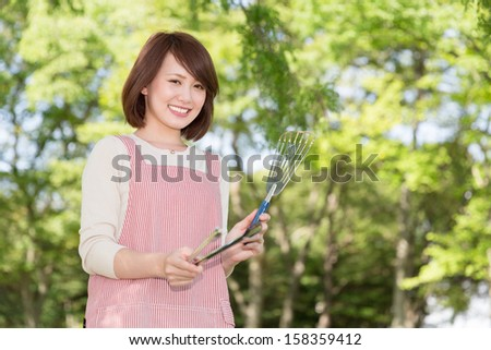 Beautiful young asian woman who enjoys a barbecue - stock photo