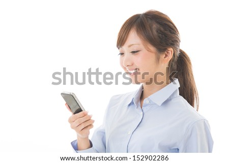Beautiful young asian woman who see a smart phone