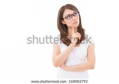 Beautiful young asian woman who thinks - stock photo