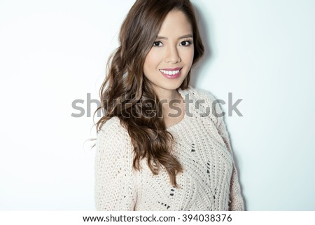 beautiful young asian woman with long hair posing in casual clothes