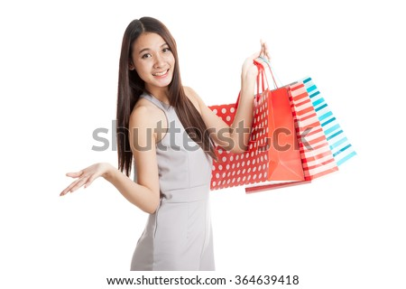 Beautiful young Asian woman with shopping bags  isolated on white background