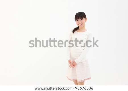 Beautiful young Asian woman with space for copy - stock photo