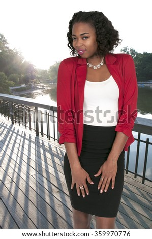 Beautiful young attractive woman modeling her dress - stock photo