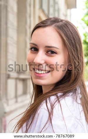 beautiful young attractive woman outdoors portrait in the streets of Paris