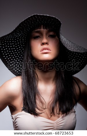 beautiful young attractive woman posing in a hat - stock photo