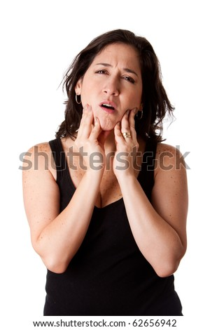 Beautiful young attractive woman with dental tooth jaw pain expression feeling unwell, holding her chin, isolated. - stock photo