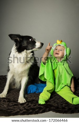 beautiful young baby with frog costume for carnival - stock photo
