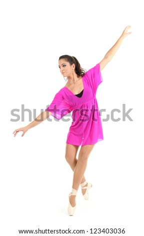 beautiful young ballerina in a pink dress isolated on white - stock photo