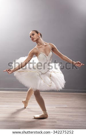 beautiful young ballerina in ballet pose classical dance