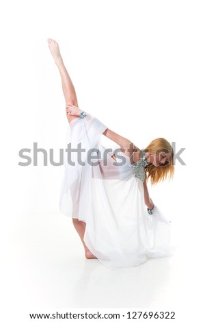 Beautiful young belly dancer, modern ballet. Girl dancing in white cloth. Beautiful young belly dancer, modern ballet. young and beautiful dancer posing on studio background.