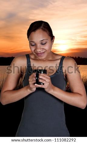 Beautiful young black African American woman drinking coffee - stock photo