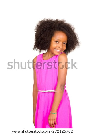 Beautiful young black girl with afro and pink dress with a shy smile expression