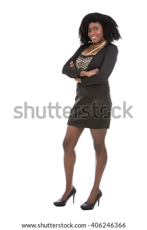 beautiful young black woman is wearing dark dress on white background
