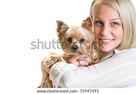 Beautiful young blond girl with cute yorkshire terrier dog, isolated on white. - stock photo