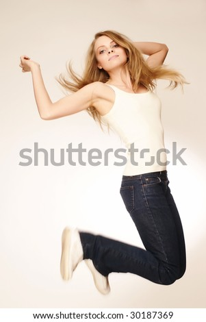 beautiful young blond in a jump - stock photo