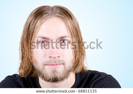 Beautiful young blond male model with beard close up - stock photo