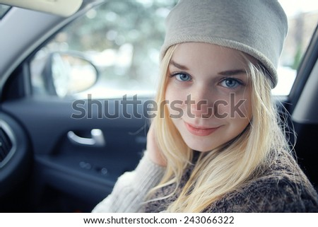 beautiful young blond teen in the car - stock photo
