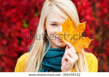 Beautiful young blond woman - colorful autumn portrait - stock photo