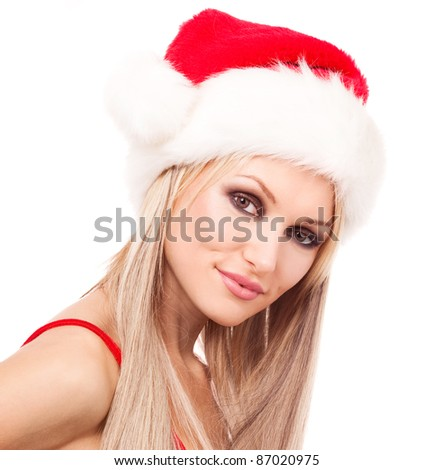 beautiful young blond woman dressed as Santa, isolated against white background - stock photo
