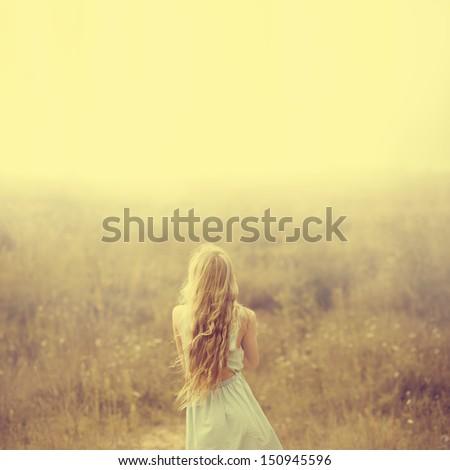 beautiful young blond woman enjoying the fabulous nature - stock photo