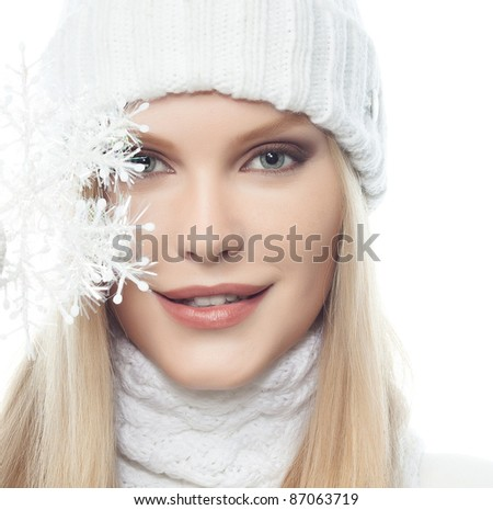 beautiful young blond woman in warm clothing isolated  on white - stock photo