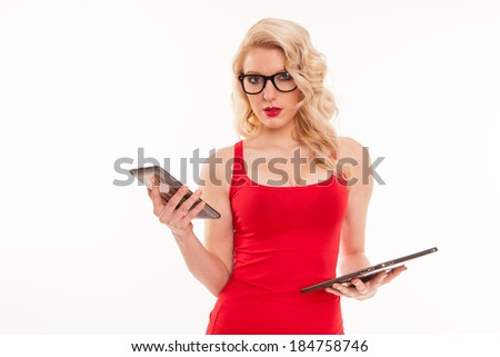 Beautiful young blond woman with glasses in red t-shirt holding a tablet computer. Isolated on white background - stock photo