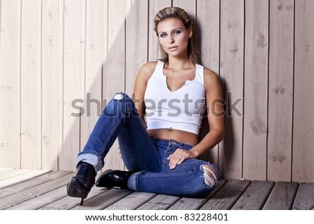 beautiful young blond women sitting - stock photo