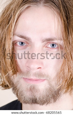 Beautiful young blonde male model with beard close up - stock photo