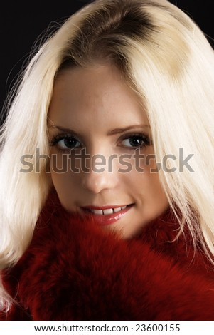 Beautiful young blonde with red scarf