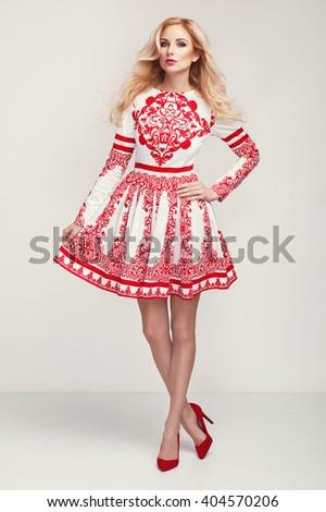beautiful young blonde woman in nice spring dress, handbag posing in a studio. Fashion spring summer photo - stock photo