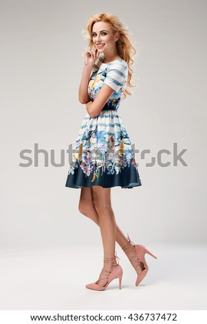 beautiful young blonde woman in nice spring dress posing in a studio. Fashion spring summer photo
