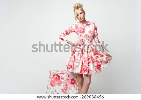 beautiful young blonde woman in nice spring dress, posing in studio. Fashion photo - stock photo