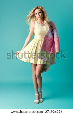 beautiful young blonde woman in nice summer dress, fashionable clothes posing in studio. Fashion photo - stock photo
