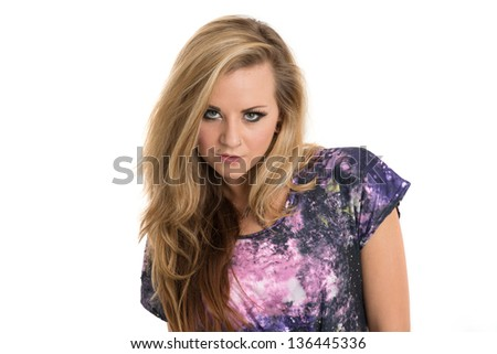 Beautiful young blonde woman in purple top - stock photo