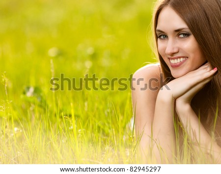 beautiful young blonde woman on the meadow on a warm summer day - stock photo