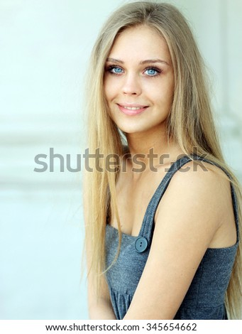 Beautiful young blonde woman. Outdoor portrait